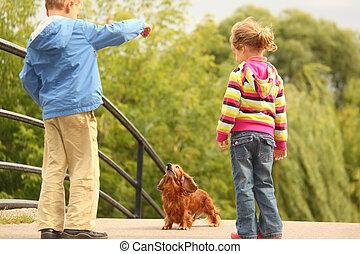 Children with dachshund outdoor