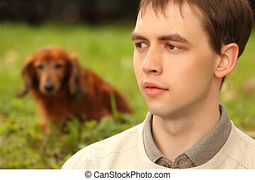 Young man with dachshund  outdoor
