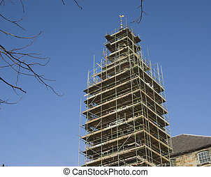Church spire with scaffolding - church spire surrounded with...