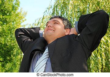 happy resting businessman outdoor in summer