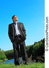 businessman outdoor in summer full body