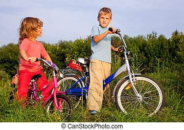 young bikers rest in the field