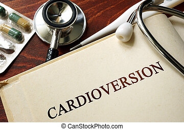Page with word Cardioversion and glasses. Medical concept.