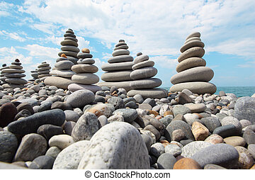 zen stones against sky, wide angle