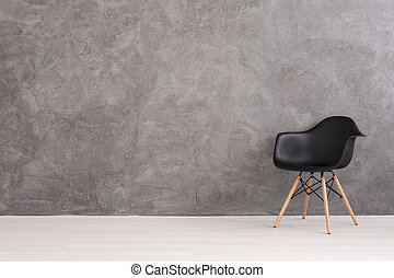 Good visibility of design chair - Black plastic chair on a...