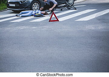 Place of a car crash - Car driver securing the place of a...