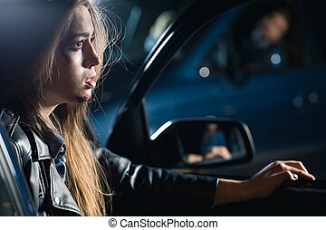 Aggrieved in a fender bender - Frightened young woman with...