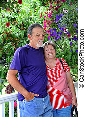 Enjoying Montana - Couple enjoys a garden in Montana They...