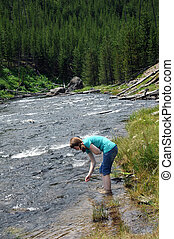 Gibbon River Visitor in Yellowstone - Attractive young woman...