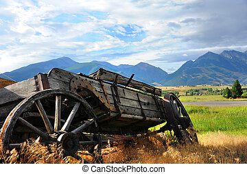 Broken Down But with View - Broken down, wooden wagon sits...