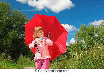 little girl with red umbrella outdoor in summer