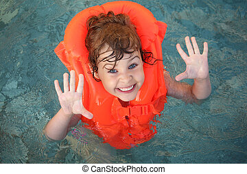 little girl in inflatable waistcoat in pool - little girl...