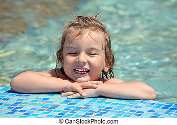 pretty little girl bathe in pool, closed eyes