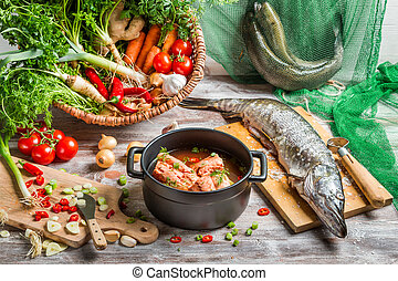 Fresh fish and vegetables for soup ingredients