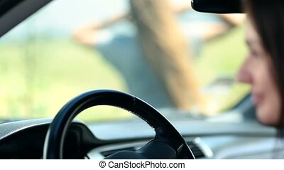 Woman's hand sliding on car's steering wheel - Close up of...