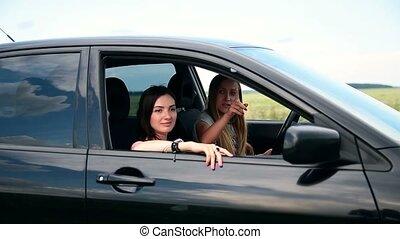 Women on roadtrip stopping in countryside - Traveler women...