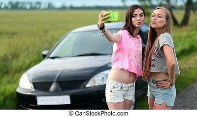 Two cute women making selfies on roadtrip - Two cute women...