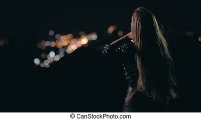 Woman enjoying night city from observation deck - Young...