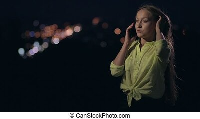 Happy woman talking on mobile phone at night - Happy smiling...