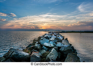 Sunset over a rock jetty on the Chesapeake Bay