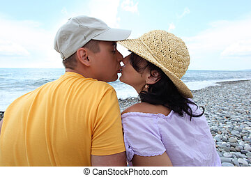 kissing pair on beach
