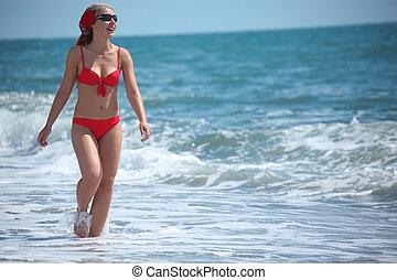 beauty girl walk in sea surf