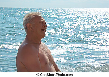 elderly smiling man on seacoast