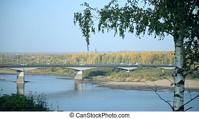 A typical bridge in Russia over the river - There is a birch...