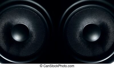 Set of round audio speakers vibrating from sound - Closeup...