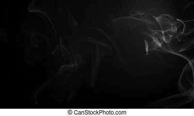 Smoke fumes against a black background