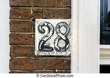 Number 28 - weathered house number twenty eight (28)