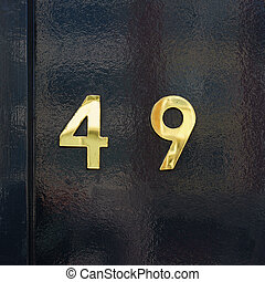 Number 49 - Gold colored house number forty nine 49