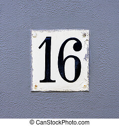 Number 16 - Hand painted house number sixteen (16) on a...