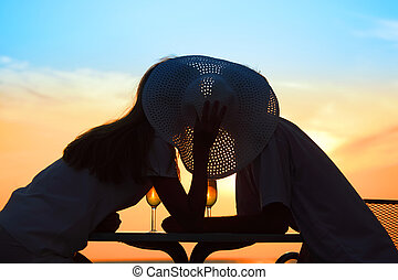 man and  woman kiss on sunset outside