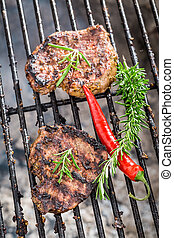 Grilled steak with rosemary and chilli
