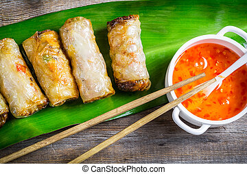 Close-up on spring rolls and sweet and sour sauce
