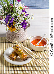 Spring rolls served with chili sauce