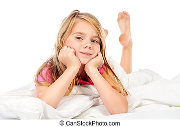 sweet dreams - Cute smiling girl in her bed in the nursery....