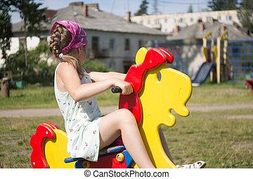 girl playing in the yard