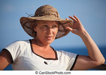 portrait of middleaged woman in hat outdoor