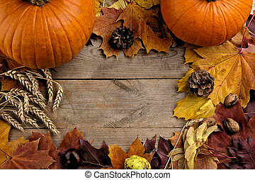 Pumpkins with autumn leaves seen birds eye view for...