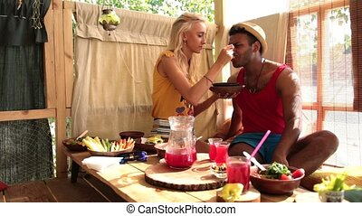 Young woman feeding her lover with healthy food - Cute...