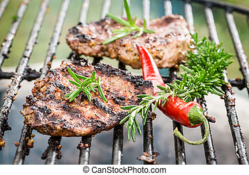 Grilled steak with chilli and rosemary