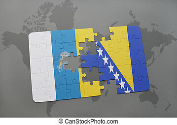 puzzle with the national flag of canary islands and bosnia...
