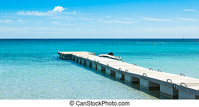 Pontoon in the turquoise water of Rondinara beach in Corsica...