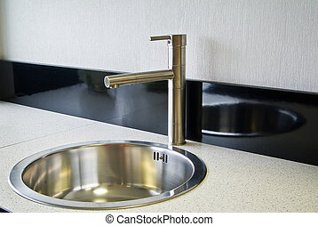 Stainless steel sink on the kitchen