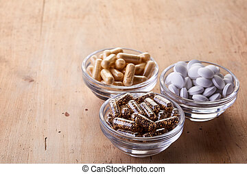 Various dietary supplements - Bowls of various dietary...