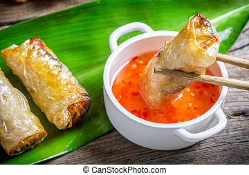 Fried spring rolls serves with sweet and sour sauce