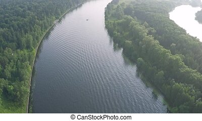 Aerial shot of anchored boat on the river - Aerial video of...