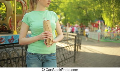 girl drinking from a paper bag in the street anti-social...